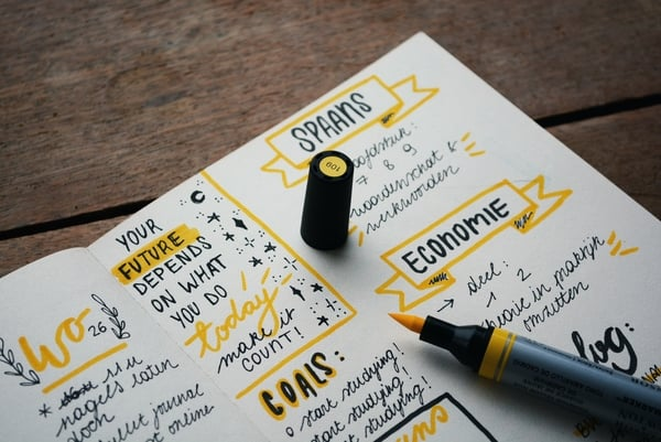 Picture of notebook full of written goals | 11-life-lessons